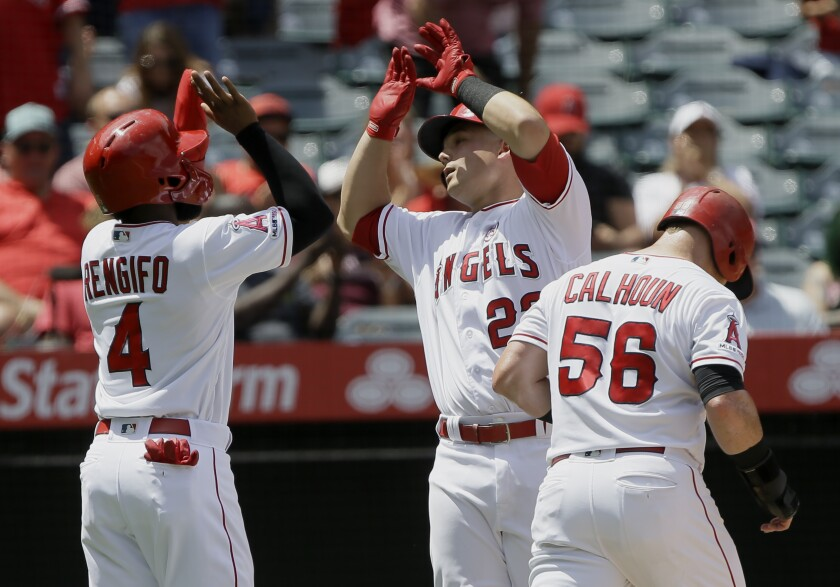 The Angels' Matt Thaiss is congratulated by teammates Luis Rengifo and Kole Calhoun after hitting a three-run homer against the White Sox on Sunday.