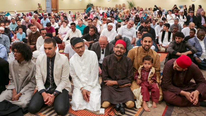 Muslims gathered Sunday to offer Eid al-Fitr prayers organized by the Middle Ground Muslim Center in Upland. Eid al-Fitr is the celebration that marks the end of Ramadan.