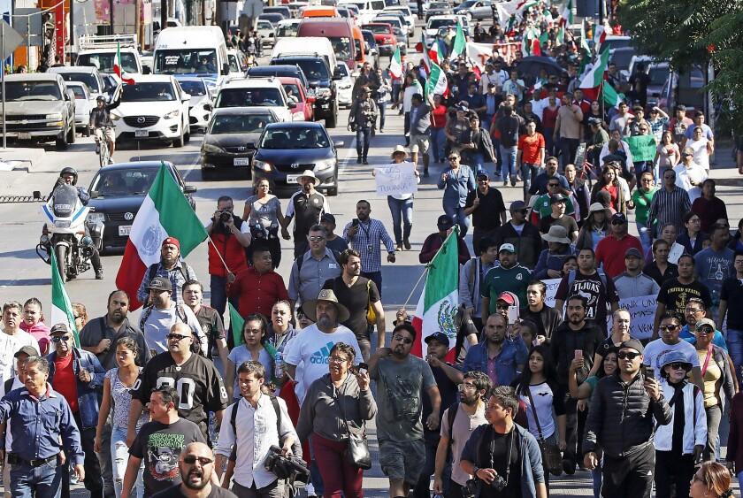 TIJUANA, MEXICO - NOV. 18, 2018. Hundreds of protesters march through downtown Tijuana on Sunday,