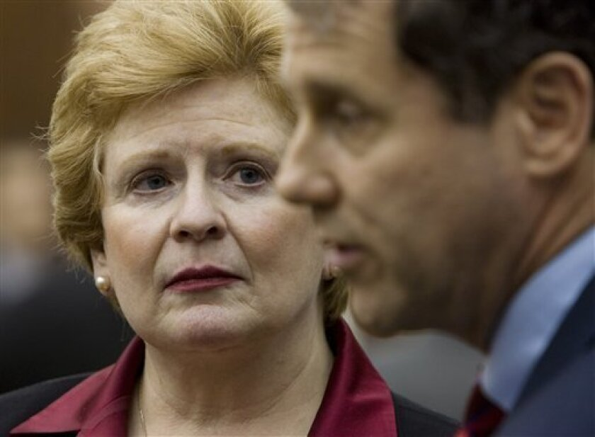 Sen. Debbie Stabenow, D-Mich, left, listens to Sen. Sherrod Brown, D-Ohio, speaking about the Senate's rejection of an emergency $14 billion loan bailout for US auto companies, Thursday, Dec. 11, 2008, on Capitol Hill in Washington. (AP Photo/Haraz N. Ghanbari)