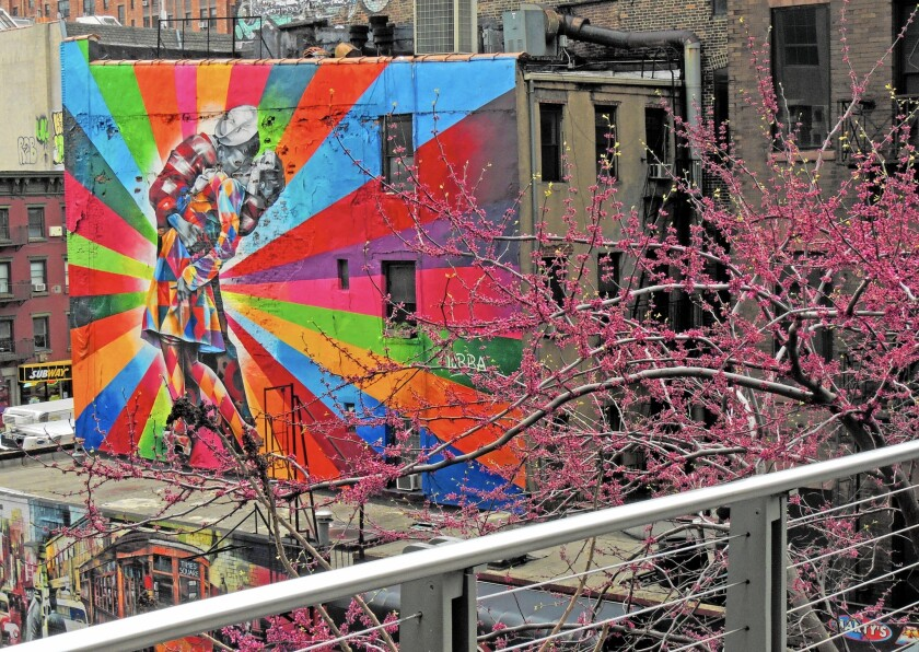 "The High Line makes a fine perch from which to see Brazilian street artist Eduardo Kobra's mural, based on the iconic 1945 photograph ""V-J Day in Times Square"" by Alfred Eisenstaedt."