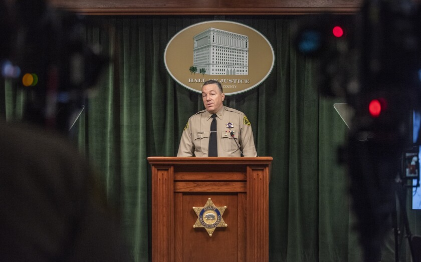 Los Angeles County Sheriff Alex Villanueva speaks at a lectern.