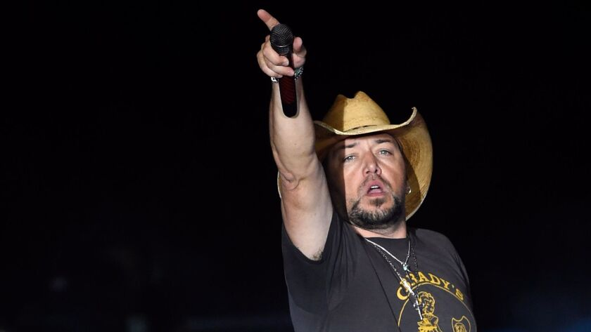 Jason Aldean on stage just before a gunman opened fire on the Route 91 Harvest country music festival, a key event in making Las Vegas a major destination for outdoor music.
