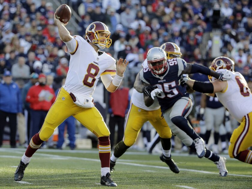 Washington Redskins quarterback Kirk Cousins (8) passes under pressure from New England Patriots defensive end Chandler Jones (95) during the second half of an NFL football game Sunday, Nov. 8, 2015, in Foxborough, Mass. (AP Photo/Steven Senne)