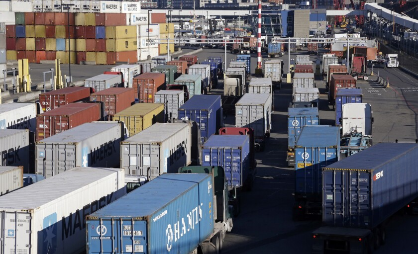 Loaded container trucks at the Port of Seattle on Tuesday, Feb. 17. Activity along the West Coast is expected to pick up following a tentative agreement Friday in a long-running labor dispute.