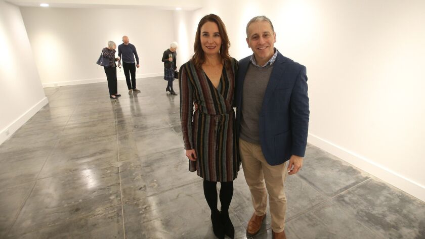 Project architect Anders Lasater and his wife Cynthia, stand on the newly restored flooring of the l