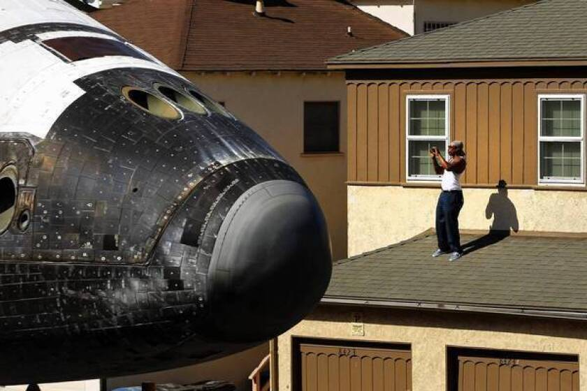 The space shuttle Endeavour travels the streets of Los Angeles on its way to the California Science Center in October. Since the shuttle fleet's retirement, NASA has no clear agenda for its human spaceflight division.