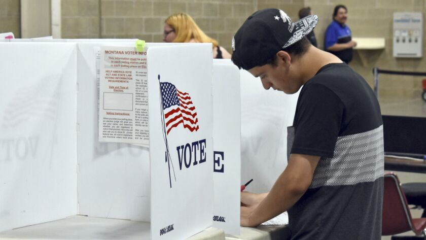 Devin Asbell fills out his primary election ballot fills out his ballot at MetraPark Arena in Billin