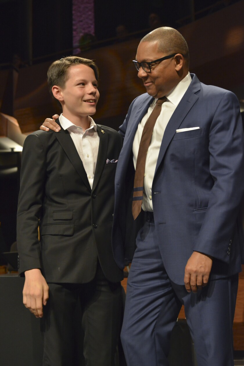 San Diego's John Murray, 15, is congratulated by Wynton Marsalis after becoming the first high school bassist to ever win Outstanding Soloist honors at Jazz at Lincoln Center's 24-year-old Essentially Ellington High School Jazz Band Competition & Festival in New York.