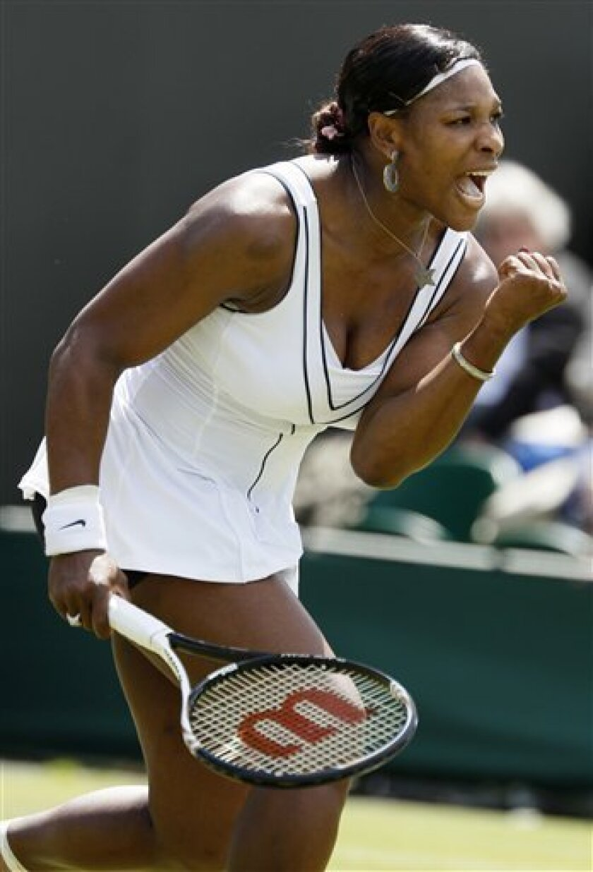 Serena Williams of the US reacts after defeating Romania's Simona Halep in their match at the All England Lawn Tennis Championships at Wimbledon, Thursday, June 23, 2011. (AP Photo/Alastair Grant)