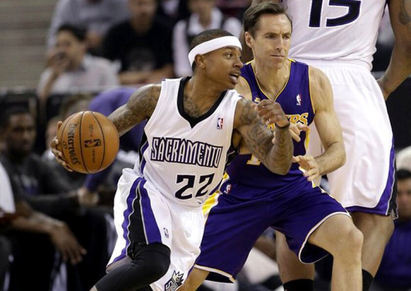 Steve Nash of the Lakers tried to play against Sacramento and Kings point guard Isaiah Thomas on Saturday but didn't last long because of a strained hamstring.