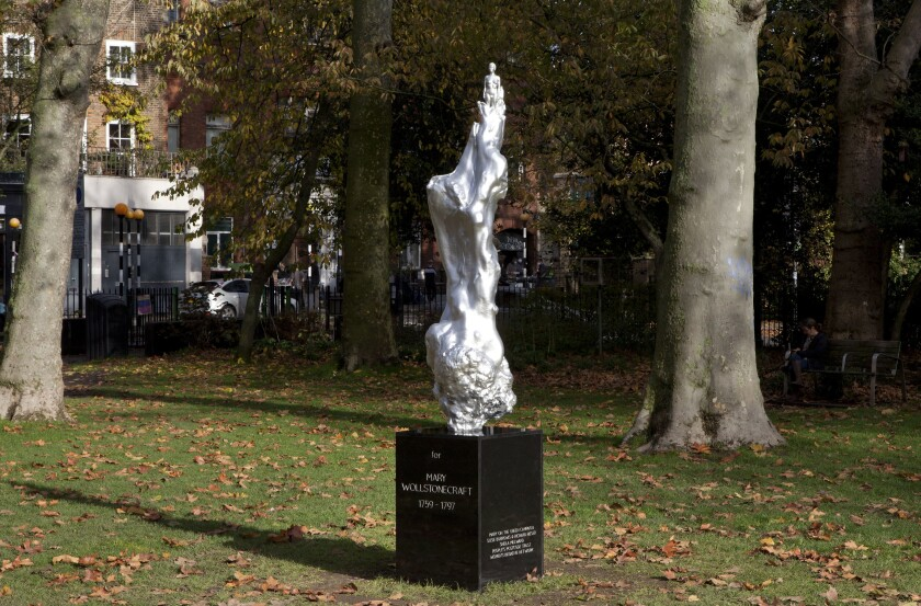 """This undated handout photo issued by the Mary on the Green campaign of Maggi Hambling's 'A Sculpture for Mary Wollstonecraft' which has been unveiled on Newington Green, London. A sculpture celebrating Mary Wollstonecraft as the mother of feminism has attracted criticism even before it was unveiled. Artist Maggi Hambling said the sculpture """"celebrates the spirit of Mary Wollstonecraft,"""" the author of the 18th-century treatise """"A Vindication of the Rights of Woman."""" The sculpture was unveiled Tuesday, Nov, 10, 2020 after a decade of campaigning and fundraising, but many critics took to Twitter to question why it had to feature a naked female figure. (Ioana Marinescu/Mary on the Green via AP)"""