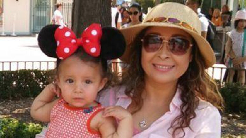 Clarissa Arredondo of San Diego, shown with a granddaughter on a visit to Disneyland, was deported to Mexico after living in the U.S. for more than 25 years.