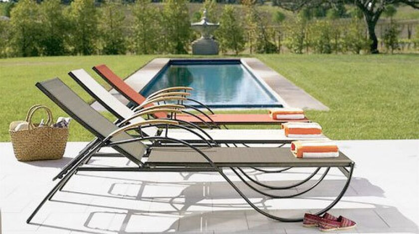 Smith & Hawken has cut the price of its streamlined Bayside chaises sold by the pair — originally $698, now $398 plus $100 for delivery.
