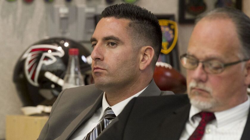 San Diego County Sheriff's deputy Richard Fischer, left, in court in Vista in May for a preliminary hearing. One of his attorneys, Chris Kowalski is at right.