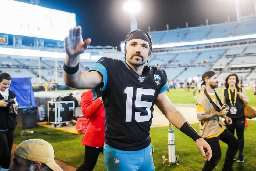 Jacksonville Jaguars quarterback Gardner Minshew waves to fans after Sunday's win over the Indianapolis Colts.