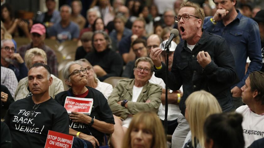 Anthony Wells, a 30-year Venice resident, voices his opposition to a planned homeless shelter during a town hall meeting Wednesday night.