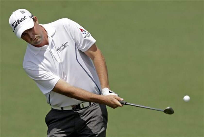 Marc Leishman, of Australia, chips to the second green during the second round of the Masters golf tournament Friday, April 12, 2013, in Augusta, Ga. (AP Photo/Matt Slocum)