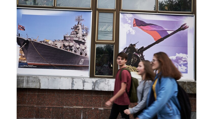 Students are seen passsing the Officer's club in Sevastopol. Oct. 30th, 2018.