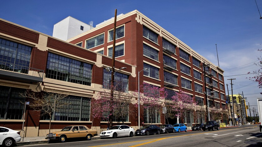 Exterior of the former Ford automobile factory that is now the home for the Warner Music Group in Lo