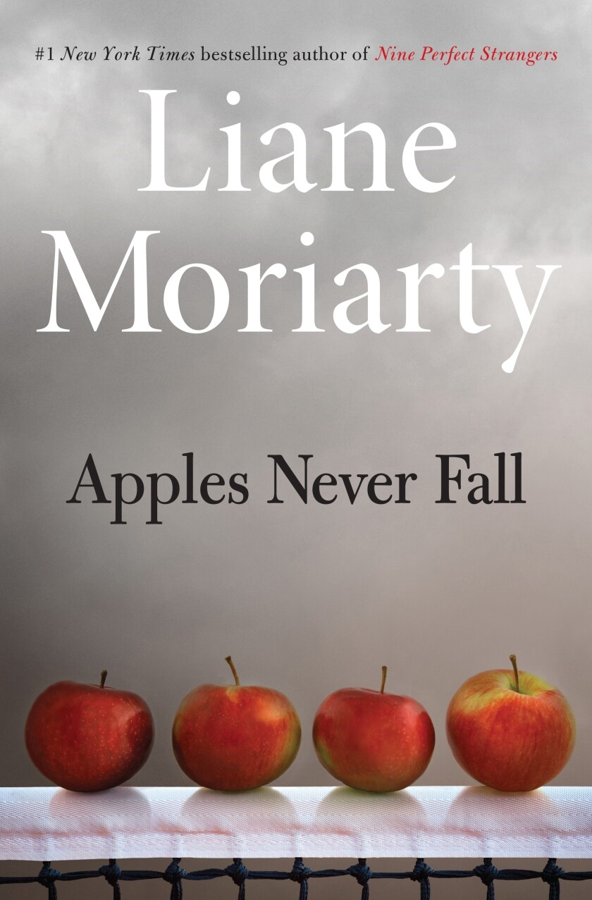 """This cover image released by Henry Holt and Co. shows """"Apples Never Fall"""" by Liane Moriarty, releasing Sept. 14. (Henry Holt and Co. via AP)"""