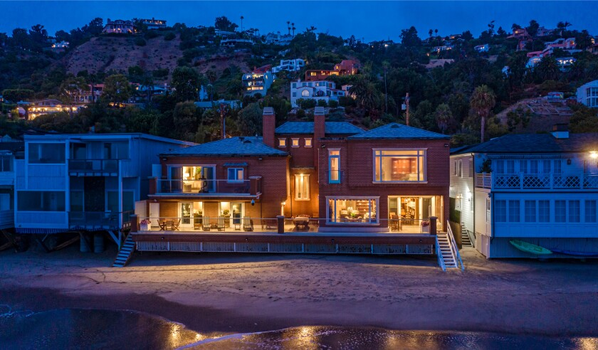 Clad in brick, the 8,000-square-foot home features seven bedrooms, nine bathrooms, an oceanfront patio and 81 feet of water frontage.