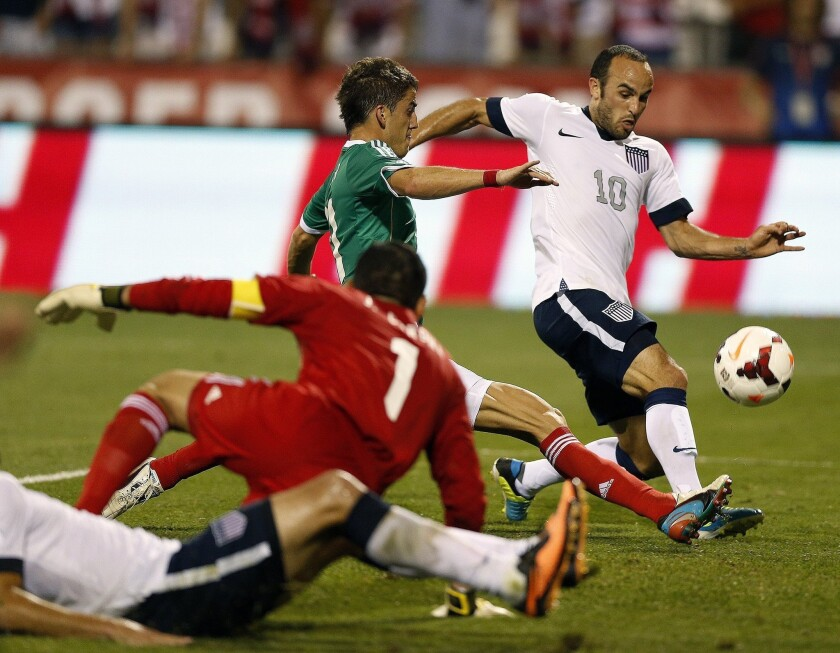 Landon Donovan, right, gets past Mexico's Hiram Mier during World Cup qualifying in Columbus, Ohio, on Sept. 10.