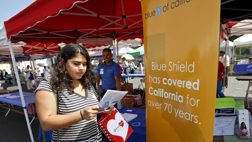 Blue Shield of California's premiums are drawing renewed scrutiny since the California Franchise Tax Board stripped the insurer of its longtime exemption for state income taxes after an audit. Above, Sophia Bracho, 20, gets info from the Blue Shield booth at the East L.A. Health Fair in 2013.