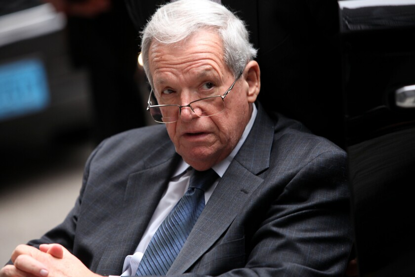 Former House Speaker Dennis Hastert leaves court in a wheelchair after his sentencing Wednesday.