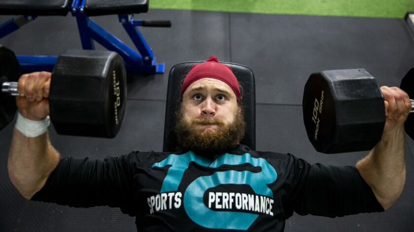 Porter Gustin trains at Athletes Choice on Feb. 20, 2019 in Trabuco Canyon. Growing up, the linebacker was a thin boy who played wide receiver and quarterback.