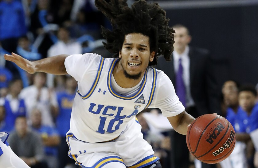 Tyger Campbell, shown in November, scores 22 points as UCLA wins 73-57 over Utah on Feb. 2, 2020.