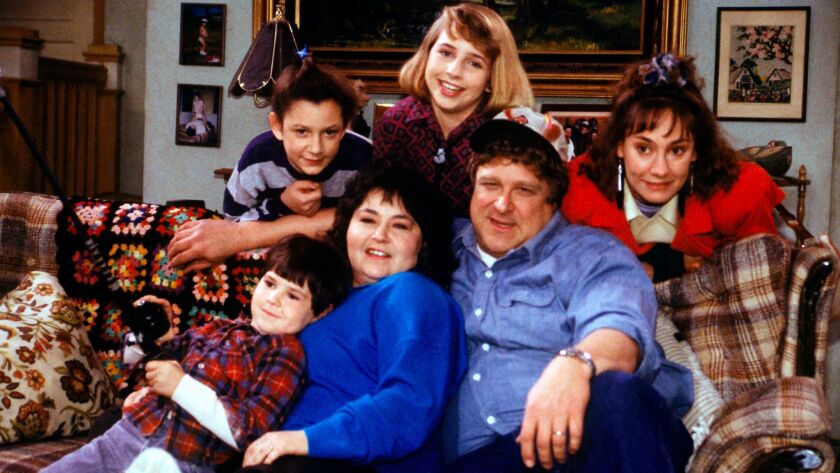 "In this undated image released by ABC, shows the cast members of ""Roseanne,"" Michael Fishman as DJ C"