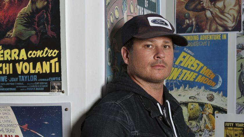 """Blink-182 co-founder Tom DeLonge, who is no longer with the band, is shown in his shop, To the Stars, in Encinitas in 2017. An animated series is being produced for TBS based on his graphic novel, """"Strange Times."""" No air date has yet been announced."""