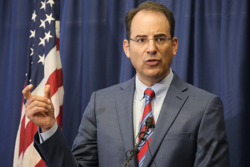 Colorado Attorney General Phil Weiser speaks at a news conference in Denver, Wednesday, Sept. 15, 2021. Weiser says a civil rights investigation begun amid outrage over the death of Elijah McClain has determined that the Aurora, Colo., Police Department has a pattern of racially-biased policing. (AP Photo/David Zalubowski)