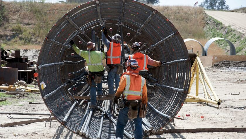 Crews work on the San Joaquin River Viaduct in Fresno.