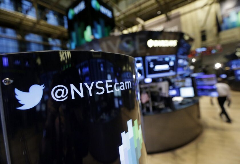 An updated phone post on the floor of the New York Stock Exchange features a Twitter logo, Monday, Nov. 4, 2013, in New York. Twitter Inc. will begin trading on the New York Stock Exchange on Thursday morning after setting a price for its IPO sometime Wednesday evening. (AP Photo/Richard Drew)