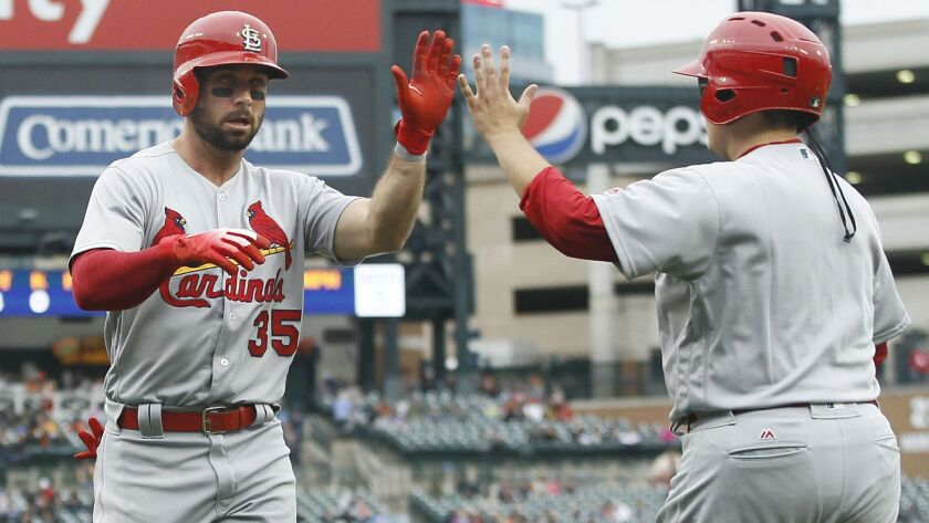 Greg Garcia of the St. Louis Cardinals celebrates after scoring against the Detroit Tigers on September 9.