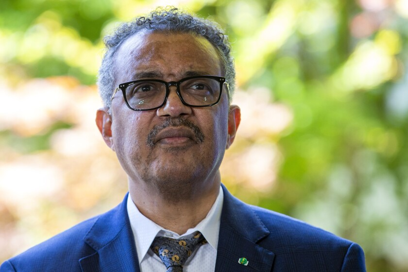 """FILE - In this June 25, 2020, file photo, Tedros Adhanom Ghebreyesus, director general of the World Health Organization (WHO), attends a press conference, at its headquarters in Geneva, Switzerland. Tedros says he will self-quarantine after being identified as a contact of a person who tested positive for COVID-19. He wrote on Twitter late Sunday, Nov. 1, 2020, that he is """"well and without symptoms"""" but will self-quarantine in """"coming days, in line with WHO protocols, and work from home."""" (Salvatore Di Nolfi/Keystone via AP, File)"""