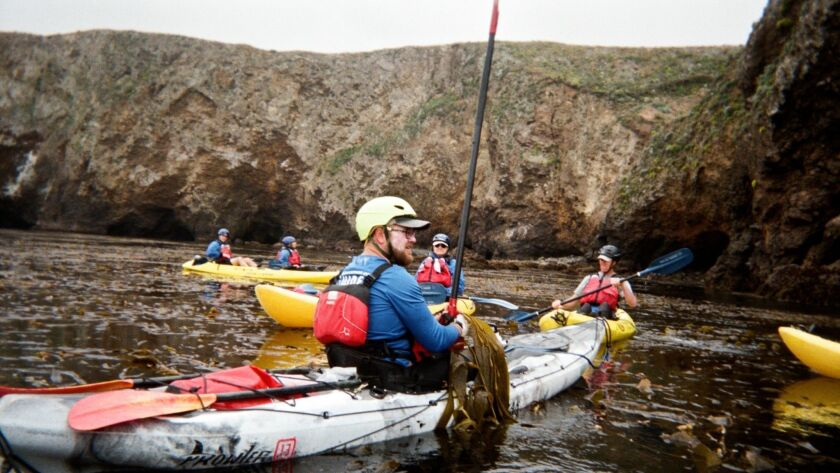 Kayak tour of sea caves. Santa Cruz Island, Channel Islands National Park. Scorpion Anchorage.