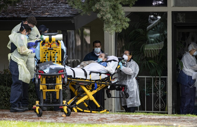 A patient is removed from a Riverside nursing home amid a COVID-19 outbreak.
