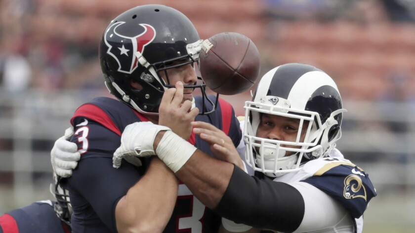 Rams defensive lineman Aaron Donald, knocking the ball from Texans quarterback Tom Savage for a fumble on one of his 11 sacks, might sit out the season finale Sunday.