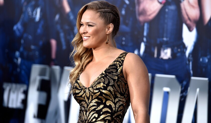 """UFC bantamweight champion Ronda Rousey, seen here at a premiere for """"The Expendables 3,"""" is encouraged by steps UFC is taking in drug testing."""