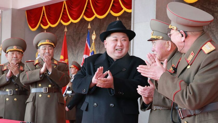 North Korean leader Kim Jong Un attends a military parade at Kim Il Sung Square in Pyongyang.