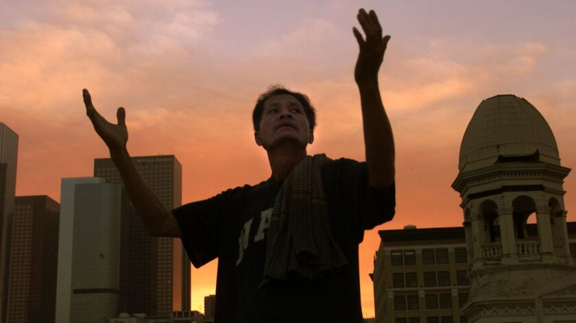 """Cambodian community member Yonn Doung rehearses for Cornerstone Theatre's """"Crossings, Journeys of Catholic Immigrants"""" at St. Vibiana's Cathedral in L.A. in 2002."""
