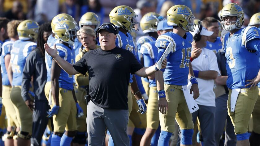UCLA head coach Chip Kelly watches his team play Stanford in the third quarter Nov. 24, 2018, at the Rose Bowl.