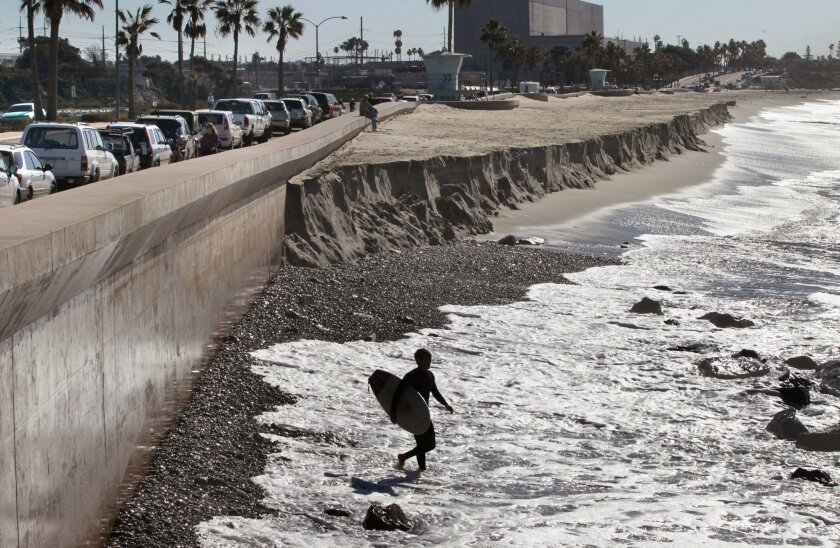 Waves wash up to the Carlsbad Seawall. The city of Carlsbad plans to release its coastline report soon.