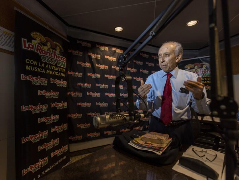"""Ruben Miranda hosts his """"El Rancho de Vicente"""" radio show."""