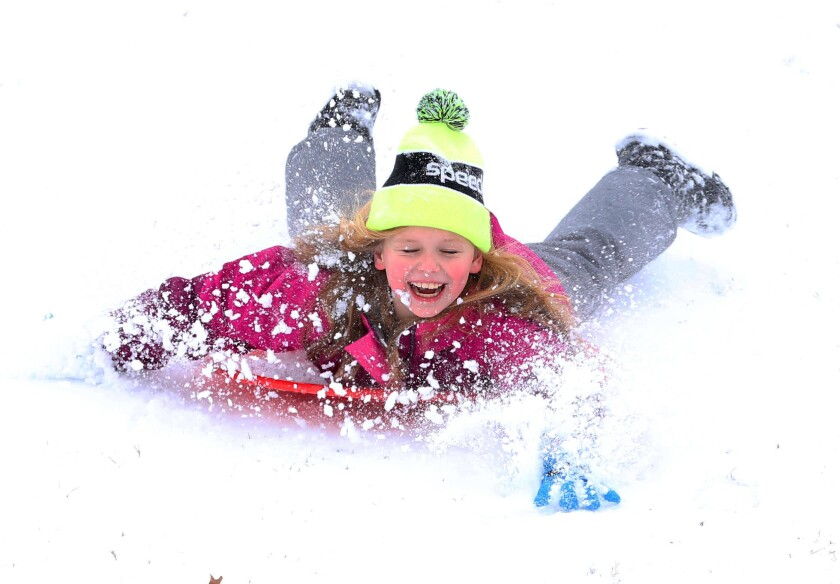 Alice Newhouse, 8, sleds down the snow covered hill next to Will Rogers High School in Tulsa on Wednesday, Feb. 5, 2020 after school was cancelled Wednesday due to a winter storm. . (Tom Gilbert/Tulsa World/Tulsa World via AP)