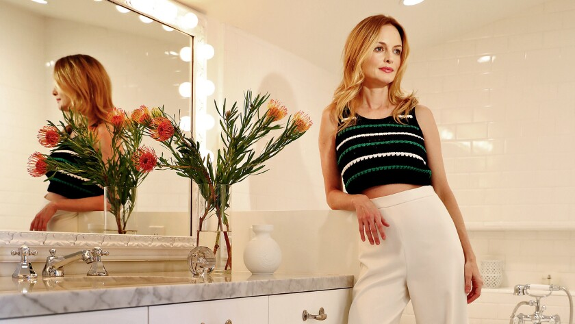 """""""This bathroom was from the '70s and really ugly ... so I wanted it to feel more like that 1920s Spanish L.A. vibe"""" to fit the home's original style, the actress says."""