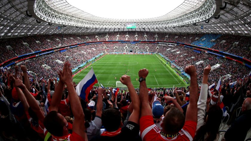 Russian fans celebrate Iury Gazinsky's opening goal in the 2018 FIFA World Cup Russia Group A match between Russia and Saudi Arabia on June 14, 2018, in Moscow.